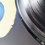 Residual wood glue on vinyl record