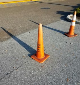 "Traffic cones with ""Dali"" stencils"