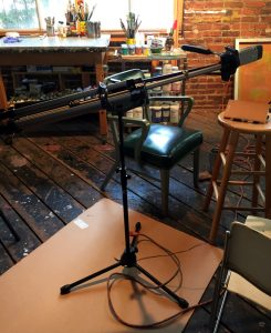 Rigged microphone in studio for art podcast