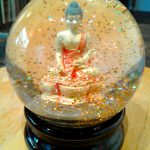 A Buddha snow globe encourages discussion in Brain Fuzz art podcast episode 33