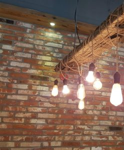 Edison bulbs, brick, and reclaimed wood